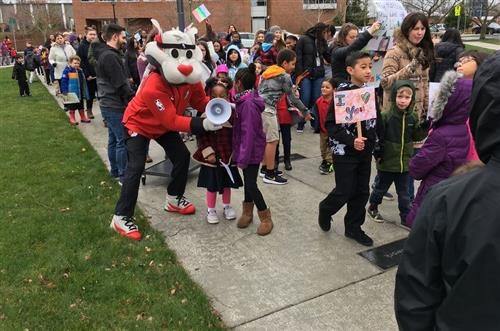 Blaze from the Portland Trail Blazers joins in on the Peace March