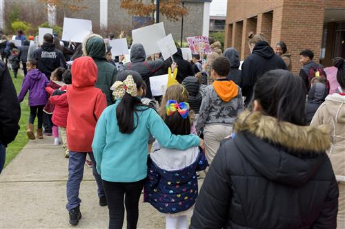 Hundreds of school, family, and community members gather to march around the Faubion/Concordia campus to demonstrate peace