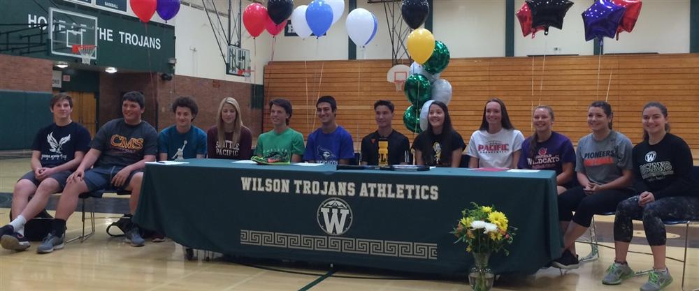 Fourteen Wilson Seniors Sign to Play Sports in College