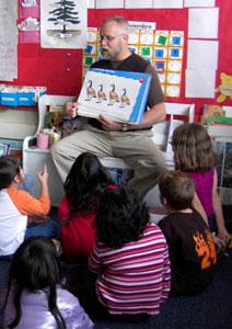 A teacher reads to students.