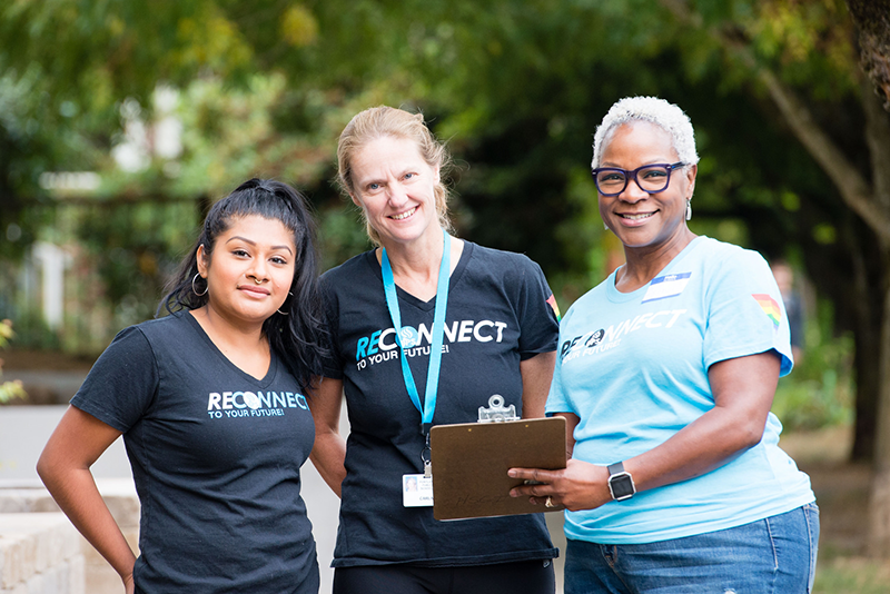 Staff and volunteers posing for a photo prior to the Reconnect event, 2017.