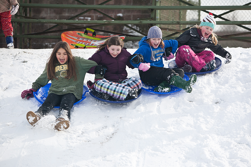 Students playing in the snow.