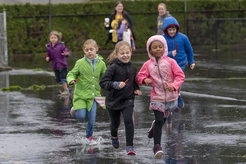Jason Lee students run in rain
