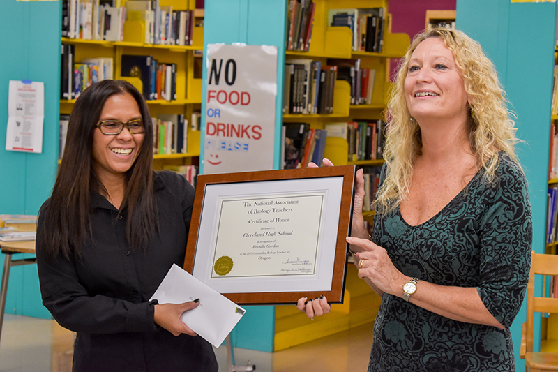 Cleveland High School's Brenda Gordon (left) accepts her award from Cheryl Hollinger.