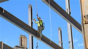 Working attaching steel beams