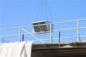 HVAC unit lifted by crane