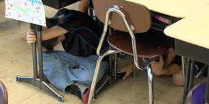 Students under their desks.
