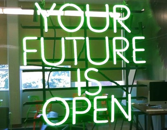 Picture of neon sign stating Your Future is Open