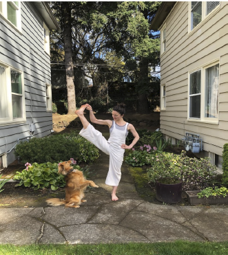 Sofia doing yoga with her dog