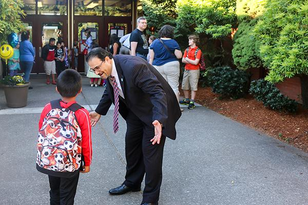 PPS CEO Yousef Awwad greeting students at Atkinson School, September, 2016