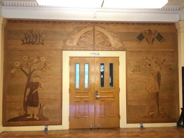 "The newly restored 1938 wood marquetry mural at Chapman Elementary School ""Send Us Forth to be Buil"