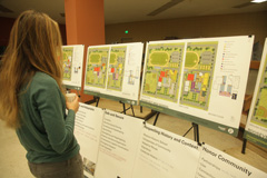 Woman looking at design plans.